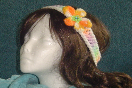 Decorative headband with orange and green flower
