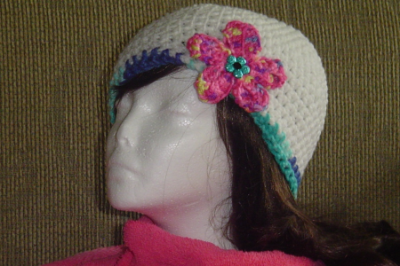 Crocheted White Hat with Pink Colorful flower and blue trim